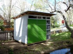 Prefab Studio Sheds Design With Glass Door and Windows in green And White Colored Wooden Wall, 37 designs in Prefab Studio Shed Design gallery Steel Storage Sheds, Shed Storage, Backyard Studio, Backyard Sheds, Shed Design, House Design, Prefabricated Sheds, Shed Blueprints, Studio Shed