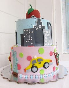 I soo want this!!! Maybe my 30th bday cake?  Two tier Manhattan New York theme cake with red Big Apple on top