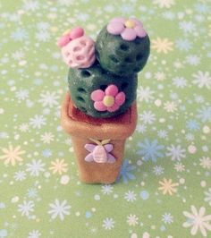 Pretty and cute DIY polymer clay charms_cactus plant with flowers in a flower pot with butterfly decorations