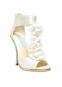 """This eye-catching chiffon floral t-strap sandal will be the perfect addition to your special day! Blue by Betsey Johnson T-strap sandal features delicate and stunning chiffon floral detail. Heel measures 4.5"""". Available in Ivory. Fully lined. Imported.A sheer, flowing fabric that drapes well on the body.A sheer, flowing fabric that drapes well on the body."""