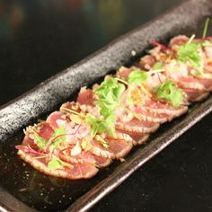 Yellow Fin Tuna Tataki with Fried Garlic, French Onion, Light Citrus Sauce & Fresh Herbs  Recipe by Jin Kung
