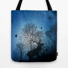 Deer in the snow  Tote Bag Snowfall in the forest, a deer is walking uphill. Photomontage of some own photos and a filter Silhouettes, birds, red deer, trees, light, moonshine, winter, blue, black, moonlight, sunlight