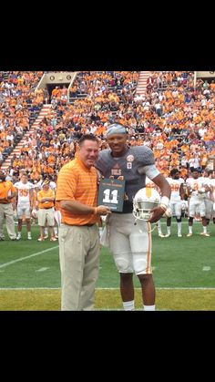 Joshua Dobbs receives the Peyton Manning leadership award from Coach bUTch Jones RollTideWarEagle.com for sports stories that inform and entertain. Plus FREE Train Deck football rules online tutorial. Fun and Easy way to learn the rules of the game you love. #Football #Vols #UT
