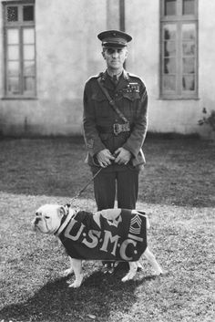 """SgtMaj Jiggs"" the first bulldog mascot of the Marine Corps with Major General Smedley D. Butler.  This photo was taken in 1926 during the production of the Marine movie, ""Tell It To The Marine."" ."