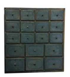 "A331 19th century New England paint decorated 18 drawer Apothecary, with the original dry blue paint,decorated with a thin blue pin strip on each drawer, dovetailed drawers , Circa 1820 ,measurements are:10"" deep x 28 1/2"" wide x 30 3/4"" tall"