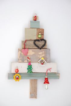 Use scrap pieces of wood to create Christmas tree and decorate as you wish.