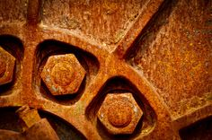 A photograph of an old rusted wheel and nuts. To purchase please go to http://memoriesoflove.imagekind.com/