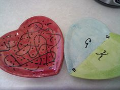 Our first Valentines day date we went to paint pottery :) Mine is the left one, Gary's is the right.
