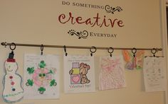 kids art display with curtain rod and curtain clips