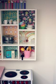 Putting wallpaper in the back of the cabinets and taking the doors off so everything is showing. <3