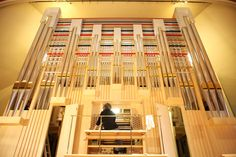 A technician from Kuhn makes careful adjustments to the new organ. © Royal Academy of Music, August 2013