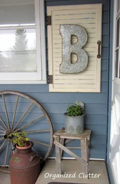 Outdoor Junk Vignette Cabinet Door Decor Project Tutorial www.organizedclutterqueen.blogspot.com