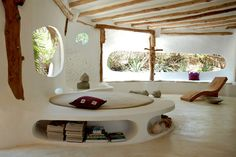 a really amazing cob home... i'm sure something like this is achievable with strawbale too!