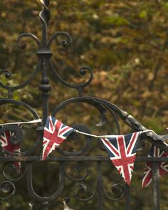 british buntings over wrought iron gate.