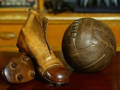 1900s Soccer Ball and Boots Photographic Print by S. Vannini at Art.com
