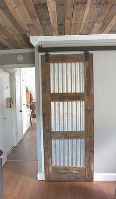 21 DIY Barn Door Projects For An Easy Home Transformation Diy Holz und Zinn Scheunentor Barn Door Closet, Pantry Closet, Barn Door In House, House Doors, The Doors, Sliding Doors, Diy Sliding Barn Door, Diy Barn Door Hardware, Barn Doors