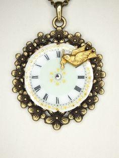 Pocket watch dial pendant in brass antik look with a brass bird an a swarovski cristal. by Kupferdach Production