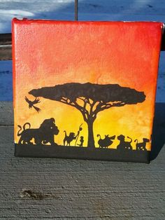 Disney's The Lion King. Made with: melted crayons (reds oranges and yellows) and black paint. All done on a white canvas.