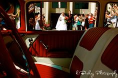 Ron and Heather Catlett getting into the 57' Chevy after tying the knot