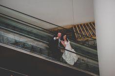 Bride and groom on escalator at JG Domestics Philadelphia || JG Domestic Wedding || Laura and Nate Get Married in Philadelphia || BG Productions || www.bgproonline.com