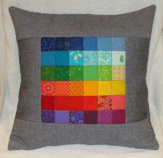 Cute pillow. I would change the gray to something more blendable (I think I made a word up) like one of the blues, reds or greens. It would make it stand out more to me.