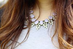 bling up a plain neckline by adding a statement necklace to a plain neckline.
