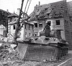 """Tank """"Panther"""",equipped with dozer blade for raking the street the rubble after the bombing."""