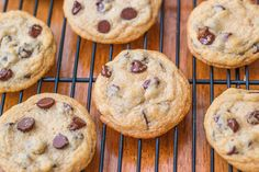 Soft-Baked, thick, and puffy chocolate chip cookies. Best-ever! By sallysbakingaddiction.com