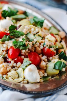 Top 10 Mediterranean Salad Recipes: Israeli Couscous Recipe with Chopped Vegetables, Chickpeas, and Artichokes| The Mediterranean Dish.