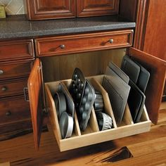 Storage and organization are two important features in your next kitchen remodel. The pullout divider tray shown is perfect for cookie sheets, cutting boards, and cake pans. Easy access and well organized. Now you might have room for just one more.  For more kitchen design ideas contact George Brown Kitchen + Bath Designer Classic Home Improvements Escondido, San Diego, CA  #kitchensByCHIGeorge #kitchen #kitchenremodel #classichomeimprovements #homeremodeling #georgebrown711…