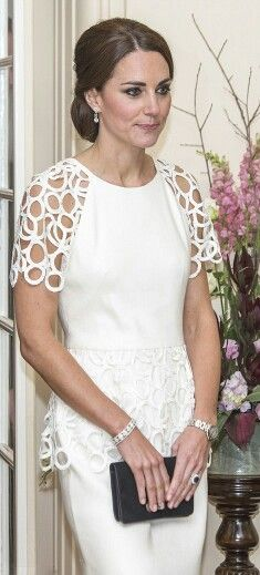 Catherine, Duchess of Cambridge elegant in these pretty pale pink Alexander McQueen separates and a set of neat pearl droplet earrings and Asprey's Woodland Pendant to complete spring get-up