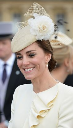 The Duchess of Cambridge thriftily recycled an Alexander McQueen coat, worn on another imp...