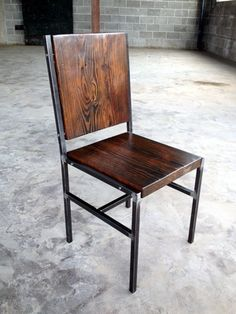 Chair Made Of Reclaimed Wood And Steel With Iron Pins