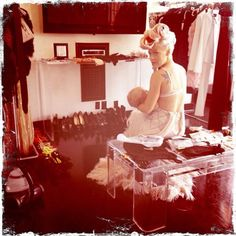 Singer Pink took a break on a photo shoot set to nurse her 1-year-old daughter Willow