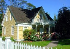 Little Yellow House with white picket fence