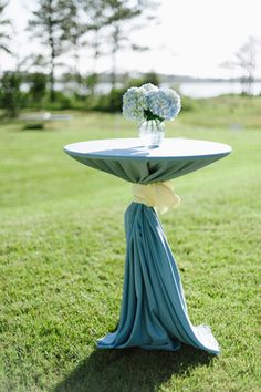 cocktail table with blue hydrangeas | Laura Gordon