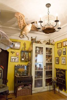 The goose freaks me out a little, otherwise a cool arrangement, and love the yellow walls!