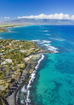 Paia, Hawaii previously functioned as a plantation village but now serves a shopping mecca for the island of Maui. - CountryLiving.com
