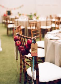 A unique chair decoration for a rustic or nature inspired wedding reception. We love the idea of signifying the bride and groom's chairs with something special.