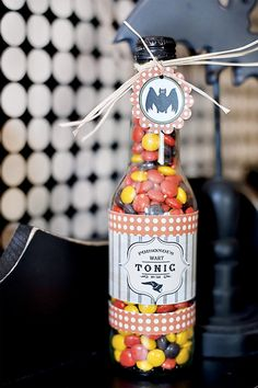 Jones Soda Bottles are easily filled with small candies (candy corn, chocolate, chips, M) and decorated for an easy favor.  Add some raffia and ribbon, a hang tag or circle tag, and printable labels and you're good to go!