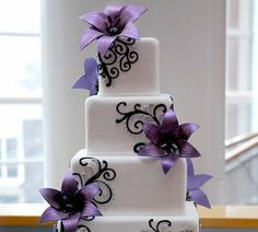 gorgeous black and white scroll work, and deep purple flowers on this cake.