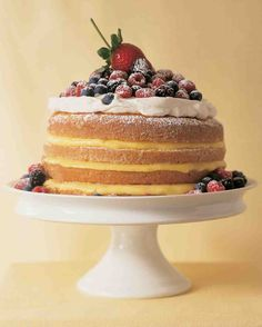 The name of this old-fashioned cake comes from its simple measuring formula: one cup butter, two cups sugar, three cups flour, and four eggs. Our take on the classic offers layers of textures and tastes, with sweetened whipped cream, custardy lemon curd, and fresh mixed berries.