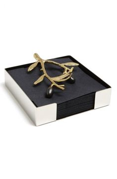 Free shipping and returns on Michael Aram 'Olive Branch - Gold' Cocktail Napkin Holder at Nordstrom.com. Michael Aram presents an elegant napkin holder designed with a sleek stainless steel base and intricately cast olive branch that secures napkins on top.