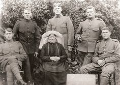 """""""Photo of my great grandma and her 5 sons. All of them had been drafted to serve in the dutch army. Picture was taken in 1916. Luckily the Netherlands stayed neutral so they didn`t have to do any actual fighting. My grandpa is the soldier sitting on the left. My great grandmother is wearing the traditional headdress for women from that time and place (Noord-Brabant, the Netherlands). It`s called a """"poffer"""" and was only worn on sundays and for special occasions. #Noord-Brabant"""""""