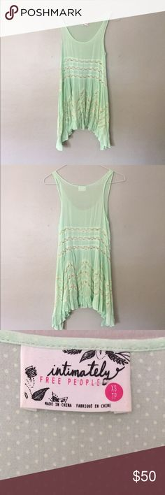 "Free People Slip Dress 🌿 NWOT: worn once under a sweater and layered. Love this piece but never wear it. XSMALL at free people // Pictures below. In perfect condition ✨ Color is a soft mint green with white details and lace. Product details for $88 brand new + technical name is ""Voile and Lace Trapeze Slip"" Free People Dresses"