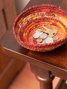 Crafts that Recycle  ..Fabric-Scraps Bowl        With use of a sewing machine, this wrapped-rope bowl works up in a jiffy.