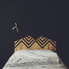 Timber and black chevron bed head. Antler wall handing. Bohemian simplicity.