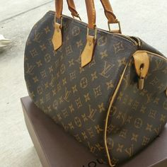 Authentic Louis Vuitton Speedy 30 Authentic. Great condition. Has water spot in 4th photo I have not tried to get out but not very noticeable. Misplaced key for the lock. Beautiful bag. Use my neverfulls and hate seeing this sit in my closet. Louis Vuitton Bags