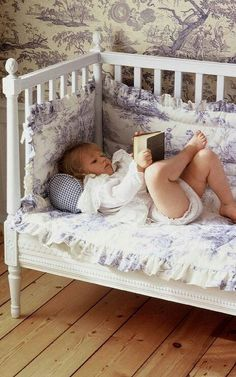 Baby reading in bed....
