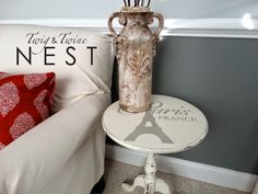 A small chalk painted table with a Simply Said vinyl design
